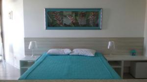 Cama ou camas em um quarto em Condado Aldeia dos Reis 114 e 213