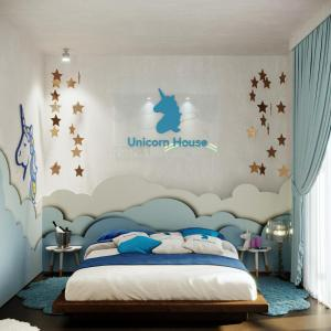 Letto o letti in una camera di The Unicorn House