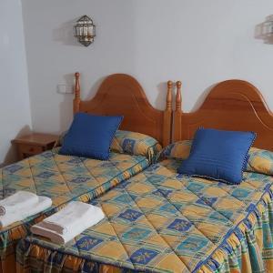 Cama o camas de una habitación en Casa Rural Pocotrigo