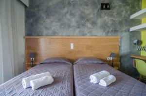 Ένα ή περισσότερα κρεβάτια σε δωμάτιο στο Ξενοδοχείο Νηρέας