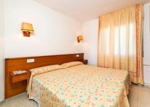Cama o camas de una habitación en Aparthotel Guitart Central Park