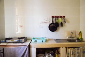 A kitchen or kitchenette at Darajani apartment