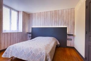 Un ou plusieurs lits dans un hébergement de l'établissement Gites des Gentianes