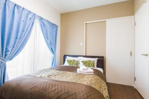 A bed or beds in a room at Mr. Kinjo in Makishi