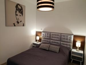 A bed or beds in a room at Les Lofts du Parc