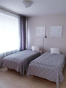 Vuode tai vuoteita majoituspaikassa Apartments N & P