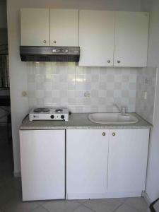 A kitchen or kitchenette at ABC Sweet Rooms