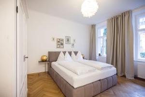 Ein Bett oder Betten in einem Zimmer der Unterkunft Exclusive Apartment Così fan tutte