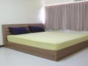 IMPACT Muang Thong Thani Service Condominium 객실 침대