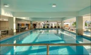The swimming pool at or near Apartamento Veredas do Rio Quente - 919