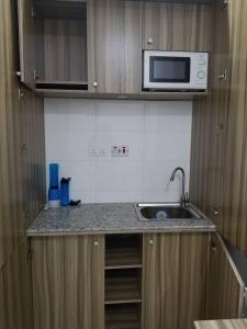 Una cocina o zona de cocina en Centurion Apartment - Maitama