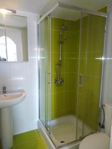 A bathroom at Nikolas Apartments