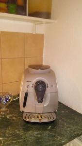A kitchen or kitchenette at Apartment Smeralova