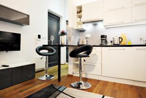 Kuchyňa alebo kuchynka v ubytovaní Tree Park Apartment