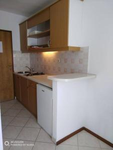 A kitchen or kitchenette at Old Town Apartments