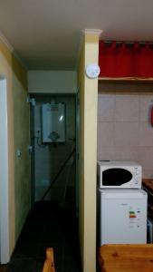 Una cocina o kitchenette en Departamentos de Alquiler Turistico: Familia Eguren