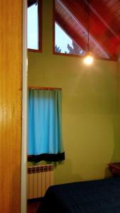 Una cama o camas en una habitación de Departamentos de Alquiler Turistico: Familia Eguren