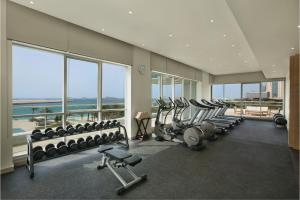 The fitness center and/or fitness facilities at DoubleTree by Hilton Dubai Jumeirah Beach