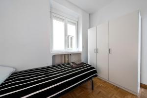 Ein Bett oder Betten in einem Zimmer der Unterkunft La Latina 5