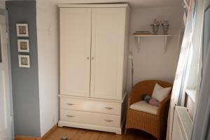 Ein Bett oder Betten in einem Zimmer der Unterkunft Das Fischerhaus