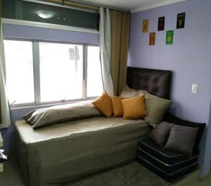 A bed or beds in a room at Apartamento 709 Norte
