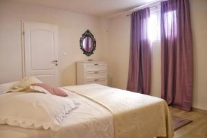 A bed or beds in a room at Villa with Sea View