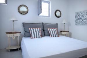 A bed or beds in a room at Aelia Paros Villas & Suites
