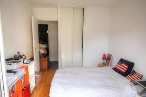 Ένα ή περισσότερα κρεβάτια σε δωμάτιο στο Beau 4 pièces Nice : vue mer