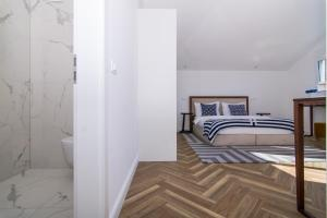 A bed or beds in a room at Seafront Luxury Apartments Fun