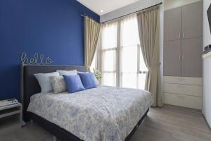 A bed or beds in a room at Tala House Bandung. Perfect for family and friends