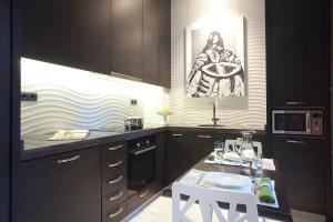 Eldhús eða eldhúskrókur á Home Club Micalet Apartments