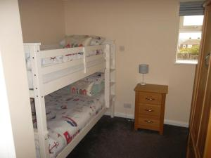 A bunk bed or bunk beds in a room at Castle View Dover
