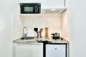 Cuisine ou kitchenette dans l'établissement Zenitude Hôtel-Résidences Toulouse Métropole