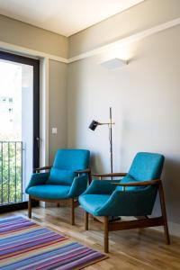 A seating area at Vibrant Porto Apartments