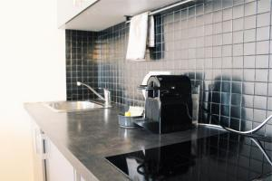 A kitchen or kitchenette at Lauriston Nice Studio