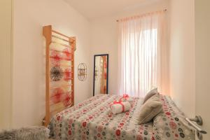 A bed or beds in a room at San Giovanni Sweet Apartment