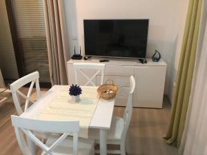 TV o dispositivi per l'intrattenimento presso Apartment More
