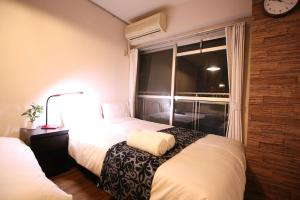 A bed or beds in a room at MG507 Cozy and clean room SHINAGAWA