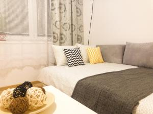 Posteľ alebo postele v izbe v ubytovaní Aparthotel Fox Center