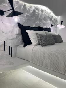 A bed or beds in a room at Studios Panos