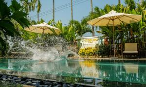 The swimming pool at or close to Hoi An Golden Rice Villa
