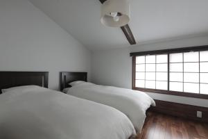 A bed or beds in a room at 京都 六花庵 Kyoto Rokkaan