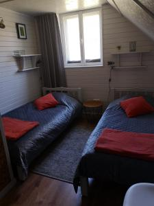 A bed or beds in a room at Lazdkalni