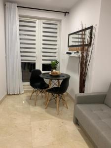 Część wypoczynkowa w obiekcie Przytulne apartamenty na Pułaskiego