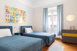 Ein Bett oder Betten in einem Zimmer der Unterkunft M&N Koukaki House