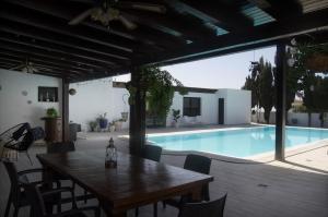 The swimming pool at or close to Villa Nazoly