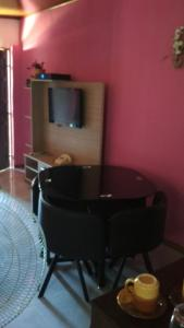 Una televisión o centro de entretenimiento en Casa La Norma