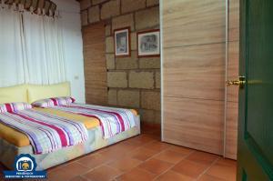 Cama o camas de una habitación en Finca La Tosca