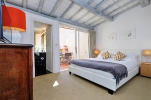 Un ou plusieurs lits dans un hébergement de l'établissement Monti Charme - My Extra Home