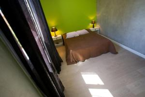 A bed or beds in a room at Résidence Padro